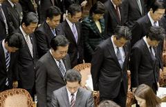 Japanese Prime Minister Yoshihiko Noda (front L) and his cabinet members observe a moment of silence at the start of a parliamentary session in Tokyo on March 9, 2012, ahead of one-year anniversary of last March 11 earthquake and tsunami. REUTERS/Kyodo