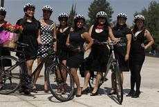 Women pose for a picture before a ride to celebrate International Women's Day in downtown Mexico City March 3, 2012. REUTERS/Tomas Bravo