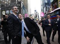 Groupon Chief Executive Andrew Mason (2nd L) jokes around with Groupon's largest shareholder and Chairman, Eric Lefkofsky, (L) outside the Nasdaq Market in Times Square following ringing the opening bell in celebration of the company's IPO in New York November 4, 2011. REUTERS/Brendan McDermid