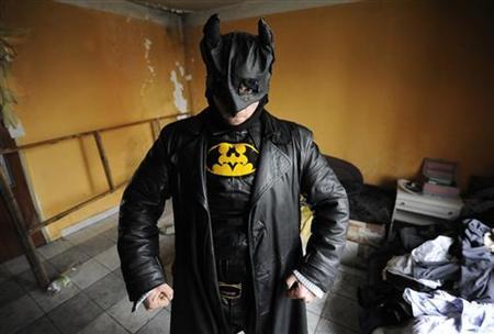 Zoltan Kohari, known as the Slovak Batman, poses in his home in the town of Dunajska Streda, some 34 miles (55 km) south of Bratislava March 8, 2012. REUTERS/Radovan Stoklasa