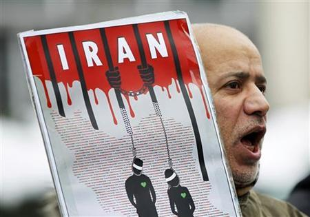 An Iranian exile shouts slogans to protest against executions in Iran during a demonstration in front of the Iranian embassy in Brussels December 29, 2010. REUTERS/Francois Lenoir