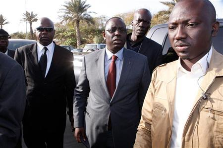 Senegalese presidential candidate Macky Sall (C) arrives to give a news conference in Dakar February 29, 2012. REUTERS/Youssef Boudlal