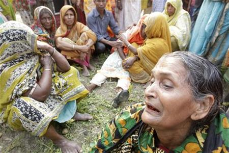 Women mourn for their relatives after a ferry was struck by a barge and capsized in Munshiganj district, some 50 km (31 miles) south of Dhaka March 13, 2012. REUTERS/Andrew Biraj