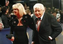 Actor Gunter Sachs and his wife Mirja (L) arrive on the red carpet for the 61st Bambi media awards ceremony in Potsdam November 26, 2009. REUTERS/Tobias Schwarz