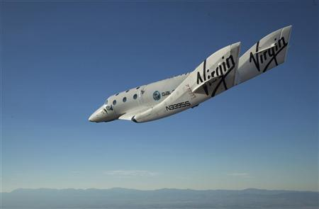 The Virgin Galactic SpaceShip2 (VSS Enterprise) glides toward Earth on its first test flight after being released from its WhiteKnight2 mothership (VMS Eve) over the Mojave, California area October 10, 2010. REUTERS/Mark Greenberg-Virgin Galactic/Handout