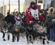 Musher Dallas Seavey of Willow, Alaska, runs his dogs down Front Street to the finish line, winning the 40th annual Iditarod Trail Sled Dog Race in Nome, Alaska March 13, 2012. Seavey, competing against both his father and grandfather, won the race on Tuesday, becoming the youngest musher crowned champion of the storied Alaska event. REUTERS/Oscar Avellaneda-Cruz