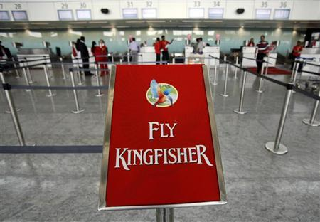 Staff stand at a near-empty Kingfisher Airlines check in area at Bengaluru International Airport in Bangalore, March 9, 2012. REUTERS/Vivek Prakash