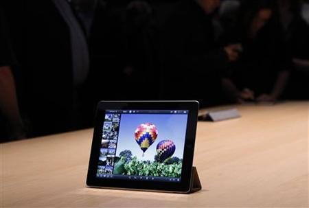 The new iPad with the iPhoto application on the screen is on displayed in the demonstration room after the Apple event, introducing the newest iPad in San Francisco, California March 7, 2012. REUTERS/Robert Galbraith