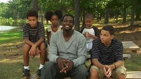 "Five-time NBA All-Star Chris Webber (C) discusses tips for dealing with bullies with a group of young people in a scene from the Cartoon Network's first documentary on stopping bullying titled, ""Speak Up,"" in this undated publicity photograph. The film will have its premiere when it is screened to the entire student body of Stuart-Hobson Middle School in Washington, D.C. on March 14, 2012. REUTERS/Courtesy Cartoon Network/Handout"