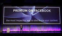 "Facebook Director of Marketing Mike Hoefflinger announces a new ""Premium on Facebook"" service as he delivers a keynote address at Facebook's ""fMC"" global event for marketers in New York City, February 29, 2012. REUTERS/Mike Segar"