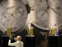An employee makes the final touch on Altanus booth at Baselworld fair in Basel, March 7, 2012. REUTERS/Christian Hartmann