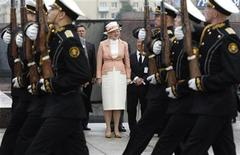 Denmark's Queen Margrethe II takes part at a wreath laying ceremony at the Monument to the Heroic Defenders of Leningrad in St.Petersburg, September 8, 2011. REUTERS/Alexander Demianchuk