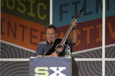 Bruce Springsteen plays the guitar as he delivers the keynote address at the South by Southwest (SXSW) Music Festival in Austin, Texas in this publicity handout photo released to Reuters March 15, 2012. REUTERS/Brian Birzer/SXSW/Handout