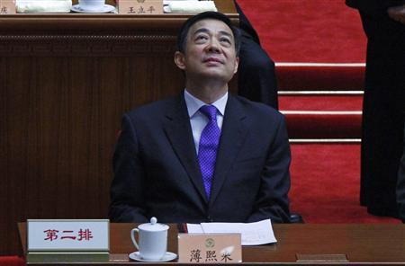 China's Chongqing Municipality Communist Party Secretary Bo Xilai looks up as he attends the closing ceremony of the Chinese People's Political Consultative Conference (CPPCC) at the Great Hall of the People in Beijing in this March 13, 2012 file photo. Bo, the Communist Party boss of China's southwestern city of Chongqing, has been removed, state news agency Xinhua said on March 15, 2012, following a scandal involving a senior aide who took refuge in a U.S. diplomatic mission last month. Vice Premier Zhang Dejiang will replace Bo, Xinhua said in a brief report, and will also keep his vice premier portfolio. REUTERS/David Gray/Files