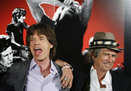 Rolling Stones band members Mick Jagger (L) and Keith Richards smile during a news conference regarding the documentary film ''Shine A Light'' directed by Martin Scorsese about the Rolling Stones in New York in this March 30, 2008 file photo. REUTERS/Lucas Jackson/Files