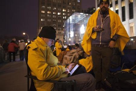 People camp out on Fifth Avenue in New York outside Apple's Fifth Avenue Store to reserve spots for Apple's new iPad due for a March 16 release March 15, 2012. REUTERS/Andrew Kelly