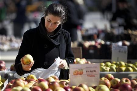 A woman shops for apples at a farmer's market in Union Square in New York February 20, 2012. REUTERS/Andrew Burton