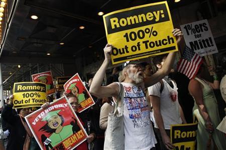 Occupy Wall Street demonstrators protest against Republican Presidential candidate and former Massachusetts Governor Mitt Romney outside the Waldorf Astoria Hotel in New York where Romney was holding a fundraiser March 14, 2012. REUTERS/Mike Segar