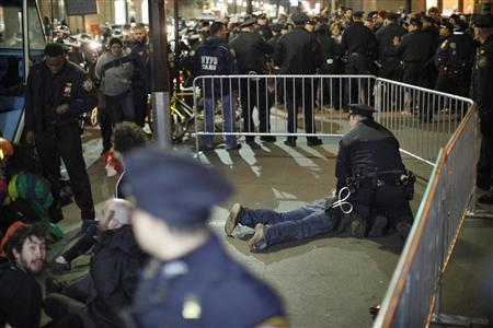Members of the Occupy Wall St movement are arrested by NYPD officers after protesting at Zuccotti park in New York March 17, 2012.REUTERS/Eduardo Munoz