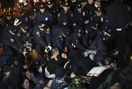 NYPD officers clash with members of the Occupy Wall St movement at Zuccotti park in New York March 17, 2012. REUTERS/Eduardo Munoz