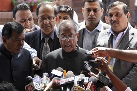 Finance Minister Pranab Mukherjee speaks with the media after presenting the 2011-2012 economic survey report, outside the parliament in New Delhi March 15, 2012. REUTERS/B Mathur