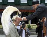 Chief Royal Priest Keshriraj Pandey crowns Nepal's new king Gyanendra at the Hanuman Palace in Kathmandu June 4, 2001. PK/CP