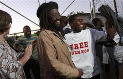 Munyaradzi Gwisai (C), who heads a small but radical pressure group called the International Socialist Organisation, celebrates with some of his co-accused outside a remind prison in Harare March 17, 2011.  REUTERS/Philimon Bulawayo