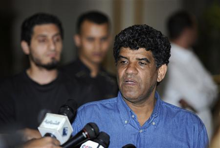 Abdullah al-Senussi, head of the Libyan Intelligence Service, speaks to the media in Tripoli in this August 21, 2011 file photo. REUTERS/Paul Hackett/Files