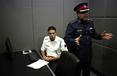 A police officer explains and shows the new interrogation room set up at the Gudaibiya Police Station in Manama March 20, 2012, during an official media visit arranged by Bahrain authorities. REUTERS/Ahmed Jadallah