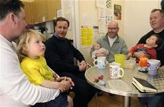 Prime Minister David Cameron (L) speaks with parents during a visit to a nursery in Chipping Norton, southern England, April 17, 2010. REUTERS/Toby Melville