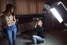 Israeli fashion photographer and model agent Adi Barkan (R) works in his studio in Tel Aviv March 19, 2012. Israeli lawmakers have banned underweight models from catwalks and commercials, a measure they hope will reduce eating disorders and promote a healthy body image. Barkan, who collaborated with lawmaker Rachel Adato on promoting the law, said impossible standards set by the fashion industry were getting too dangerous. Picture taken March 19, 2012. REUTERS/Nir Elias