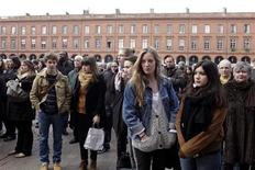 People observe a minute of silence at Capitole's place in Toulouse March 20, 2012 to pay tribute to the four victims killed by a gunman at a Jewish school in Toulouse on Monday. REUTERS/Jean-Philippe Arles
