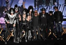 Rock bands Kiss (from L-R) Tommy Thayer, Gene Simmons, Eric Singer and Paul Stanley and Motley Crue (from R-L) Tommy Lee, Mick Mars, Nikki Sixx and Vince Neil pose at a news conference to announce the Kiss, Motley Crue: The Tour in Hollywood, California March 20, 2012. REUTERS/Mario Anzuoni