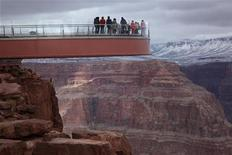 Visitors stand on a skywalk extending out over the Grand Canyon in this view on the Hualapai Indian Reservation, Arizona February 28, 2012. REUTERS/Robert Galbraith