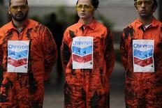 Greenpeace members protest in front of the Chevron oil company headquarters in Rio de Janeiro in this November 18, 2011 file photograph. REUTERS/Ricardo Moraes/Files