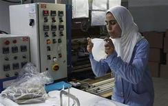 Tunisian employees work at an underwear factory in Sfax, 260 km (162 miles) south of capital Tunis March 22, 2012. A string of countries on and around the fringes of western Europe are becoming new centers of fashion clothing manufacture as China's factories and laborers move up in the world and brands discover pliant suppliers conveniently close to home. REUTERS/Zoubeir Souissi