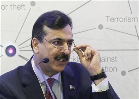 Pakistan Prime Minister Syed Yusuf Raza Gilani attends a session at the World Economic Forum (WEF) in Davos, January 26, 2012. REUTERS/Arnd Wiegmann/Files