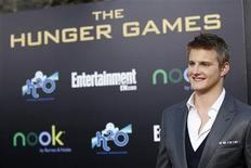"""Cast member Alexander Ludwig poses at the premiere of """"The Hunger Games"""" at Nokia theatre in Los Angeles, California March 12, 2012. REUTERS/Mario Anzuoni"""
