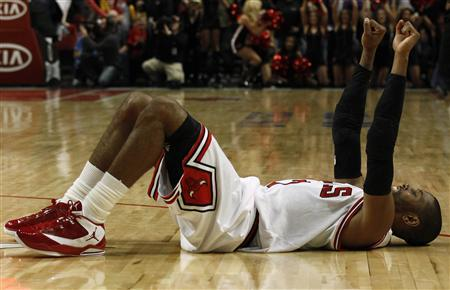 Chicago Bulls' C.J. Watson celebrates his team's win over the Toronto Raptors in overtime during their NBA basketball game in Chicago March 24, 2012. REUTERS/Jim Young