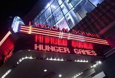 """A marquee advertising """"The Hunger Games"""" is seen at the AMC Loews Lincoln Square Theatre in New York March 22, 2012. The film is based on the popular young adult book series by Suzanne Collins. REUTERS/Allison Joyce"""
