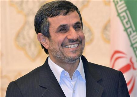 Iranian President Mahmoud Ahmadinejad smiles during a meeting with Tajikistan's President Emomali Rahmon in Dushanbe March 24, 2012. REUTERS/Stringer