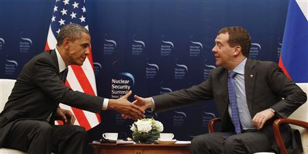U.S. President Barack Obama shakes hands with Russian President Dmitry Medvedev in a bilateral meeting before they both attend the 2012 Nuclear Security Summit later today in Seoul, South Korea, March 26, 2012. REUTERS/Larry Downing