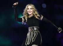 Madonna performs during the halftime show in the NFL Super Bowl XLVI football game in Indianapolis, Indiana, February 5, 2012. REUTERS/Jeff Haynes