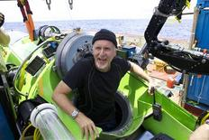 """Titanic"" film director James Cameron gives two thumbs-up as he emerges from the Deepsea Challenger submersible after his successful solo dive to the deepest-known point on Earth, reaching the bottom of the Pacific Ocean's Mariana Trench southwest of Guam in a specially designed submarine in this photograph released March 26, 2012. REUTERS/Mark Thiessen/National Geographic/Handout"