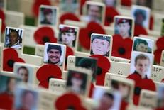 Crosses commemorating the British military casualties in Afghanistan are seen in the Field of Remembrance outside Westminster Abbey in central London November 10, 2011. REUTERS/Suzanne Plunkett