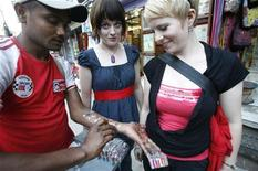 Tourists look at a tattoo vendor during a tourism festival in Kathmandu organized to celebrate World Tourism Day September 27, 2008. REUTERS/Deepa Shrestha