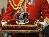 The Imperial State Crown is carried in for Britain's Queen Elizabeth during the annual State Opening of Parliament in London November 18, 2009. REUTERS/Toby Melville