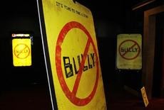"""Movie posters are seen for the documentary film """"Bully"""" during its Los Angeles premiere in Hollywood March 26, 2012. REUTERS/Danny Moloshok"""