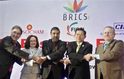 "Brazilian Trade Minister Fernando Pimentel (L-R), Russia's Economic Development Minister Elvira Nabiullina, India's Trade Minister Anand Sharma, China's Minister of Commerce Chen Deming and South African Minister of Trade and Industry Rob Davies, shake hands during a group photograph at the BRICS Summit Forum themed ""BRICS Partnership for Stability, Security and Growth"" in New Delhi March 28, 2012. REUTERS/Vijay Mathur"