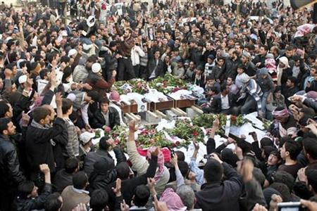 Syrians attend a mass funeral for people whom anti-government protesters said were killed by Syrian security forces in earlier protests against Syria's President Bashar al-Assad, in Duma near Damascus March 26, 2012. REUTERS/Shaam News Network/Handout